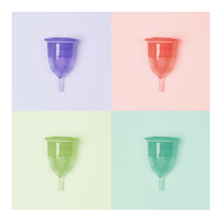 Collage in trend colors. Four menstrual cups close-up on a colour background. Pink, yellow, blue, green. Zero waste concept, eco-friendly lifestyle, reduced consumption