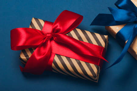 Luxuriously wrapped gifts with lush ribbon. Trending red and blue colors. Merry Christmas, St. Valentines Day, Happy Birthday and other holidays concept. Stok Fotoğraf
