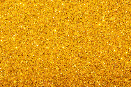 Golden festive background with sparkles. The concept of the celebration, the day of St. Valentine, New Year, birthdays, ceremonies, events, etc.
