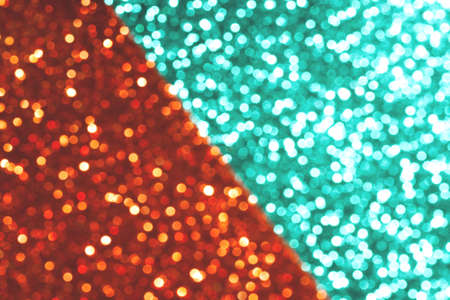 Mint and red festive background with sparkles in the bokeh. The concept of the celebration, the day of St. Valentine, New Year, birthdays, ceremonies, events, etc.