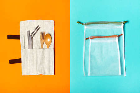 Set of reusable items for an eco-friendly lifestyle. Eco bags, metal tubes, wooden fork and spoon. Zero waste concept, plastic-free, organic, eco-friendly shopping