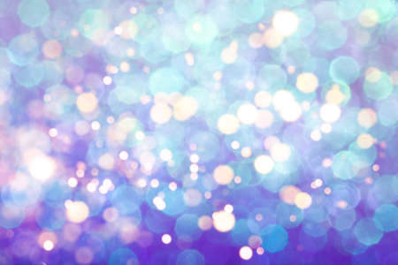 Blue festive background with sparkles in the bokeh. The concept of the celebration, the day of St. Valentine, New Year, birthdays, ceremonies, events, etc. 免版税图像