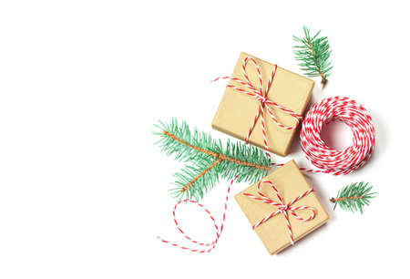 Christmas composition with gifts, branches and holiday elements isolated on a white background. Copy space. Flat lay. Merry Christmas, New Year, winter concept.