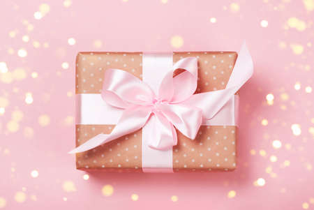 Luxurious gift on a trendy pink colors. Present for St. Valentines day, weddings, engagements, Mothers Day, birthday, New Year, Christmas, holidays Stock Photo