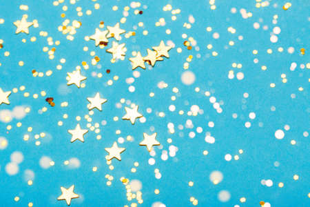 Trendy blue background with golden stars. The concept of celebrations, the Day of St. Valentine, Christmas, New Year, holiday, birthday, etc. Stock Photo