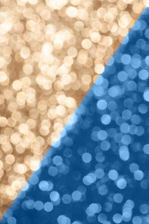 Blue and beige festive background with sparkles in the bokeh. The concept of the celebration, the day of St. Valentine, New Year, birthdays, ceremonies, events, etc.