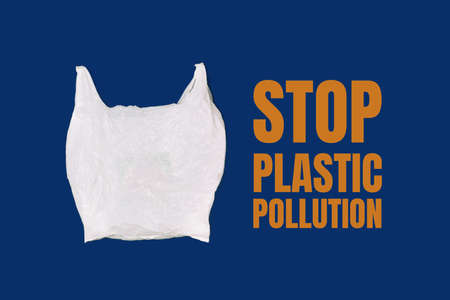 Empty white plastic bag on a blue background. Concept Stop plastic pollution, ecology, zero waste. Stock Photo