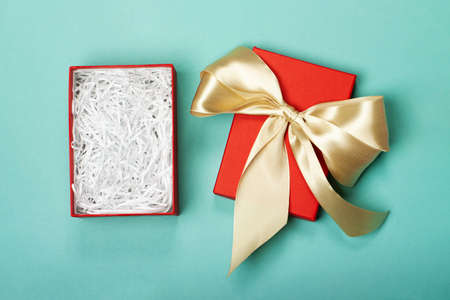 An opened gift box with a bow in which you can easily put any item. Trendy colors. Merry Christmas, St. Valentines Day, Happy Birthday and other holidays concept.