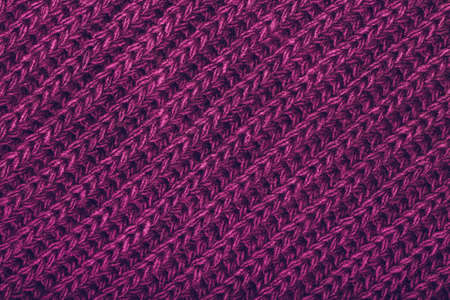 Knitted magenta scarf texture. The concept of cozy, comfort, warm, softness or winter Stock Photo