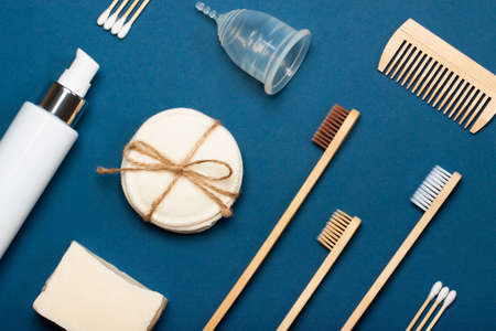 Set of eco-friendly plastic-free body care items on the blue background. Zero waste concept, plastic-free, organic, eco-friendly shopping