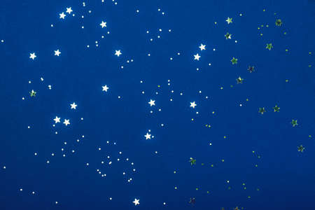 Trendy blue background with stars. The concept of celebrations, the Day of St. Valentine, Christmas, New Year, holiday, birthday, etc.