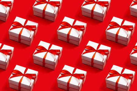 Pattern of trendy attractive minimalistic gifts on the red background. Merry Christmas, St. Valentines Day, Happy Birthday and other holidays concept.