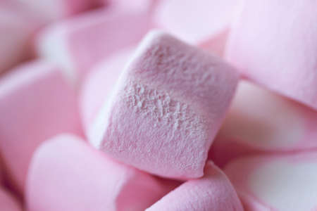 Heap of marshmallows in the shape of hearts on a pink background. The concept of St. Valentines Day, love, sweets Stock Photo
