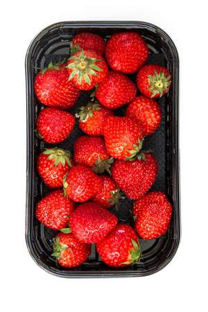 juicy ripe strawberry in supermarket box on white background