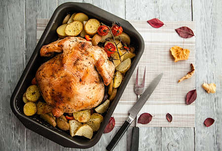 tasty roast chicken and potato slices for thanksgiving day holiday,top view