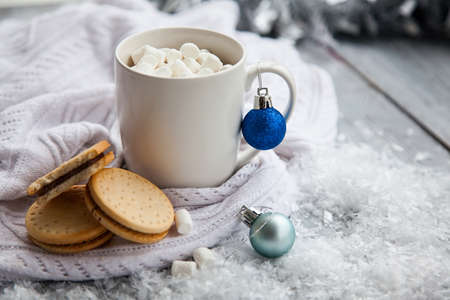 Cup of cacao with marshmallow and cookies on Christmas wooden background