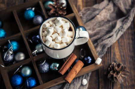 Cup of coffee and marshmallow on Christmas wooden background. Stok Fotoğraf