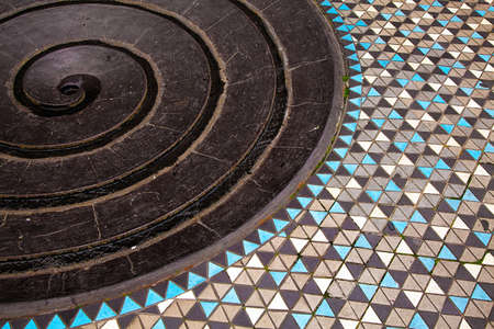 Part of abstract spiral fountain with mosaic floor, top view. Unusual places in Germany.