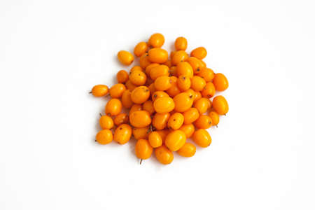Handful of useful medicinal sea buckthorn berries on a white isolated background