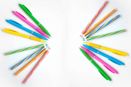A fan of multicolored handles on a white background. Simple background for business and school Stock fotó