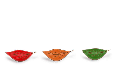 Three autumn leaves of different colors on a white background are arranged in a row. Stock fotó