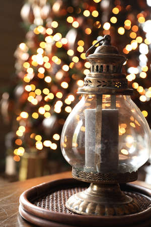 Vintage lamp on the Christmas table in lights. Christmas background Stock fotó
