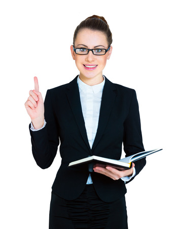 business woman holding an open book in astonishment points a finger up photo