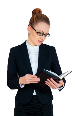 business woman looking at the open book photo