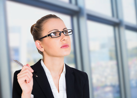 woman handle success: Business woman thinking, background office Stock Photo