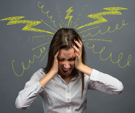 young girl suffering from a headache photo