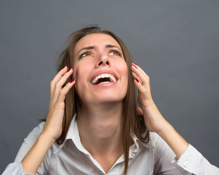 hysterics: Business woman screaming in hysterics