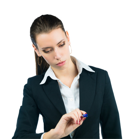 businesswoman writing something in the air with marker. Isolated on white background photo
