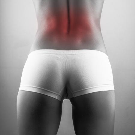muscular anatomy: backache woman. black and white photo Stock Photo