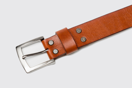 Leather belt isolated on gray background.
