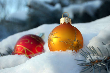 Colored balls on the Christmas tree in snow