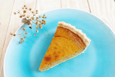 pumpkin pie: Traditional Thanksgiving homemade pumpkin pie slice on the plate