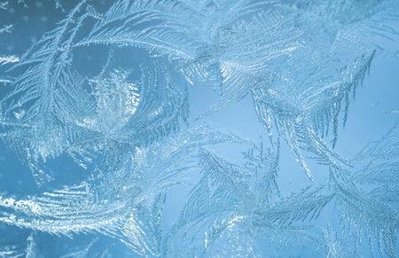 Frosty pattern on the window pane. Winter background