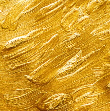 gold textured background: Golden background of brush strokes. Textured gold background Stock Photo