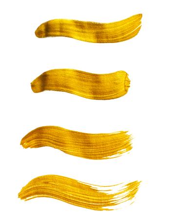 gilding: Set of gold acrylic brush strokes isolated on white background Stock Photo
