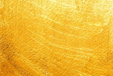 Fondo pintado de oro. Textura de papel dorado Foto de archivo