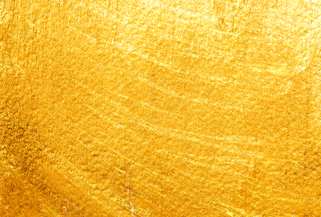 Goldener gemalter Hintergrund. Goldpapierstruktur Standard-Bild