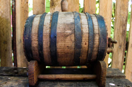 Wooden keg outside with wine