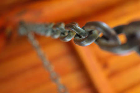 manacle: Chains from a swing bench Stock Photo