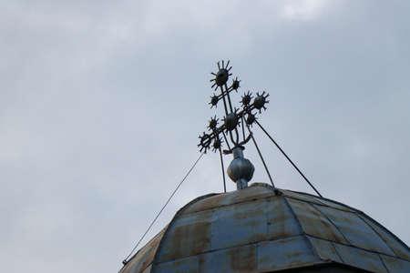 Iron cross on sheet church