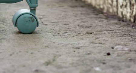 abandonment: bluish wheel on gray asphalt