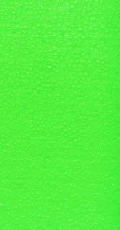 polyfoam: polyfoam the painted in bright green color, uneven surface, small drawing a circle, glints in the sun,