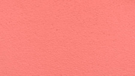 polyfoam: polyfoam the painted in pink color, uneven surface, small drawing a circle, glints in the sun,