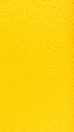 polyfoam: polyfoam the painted in bright yellow color, uneven surface, small drawing a circle, glints in the sun,