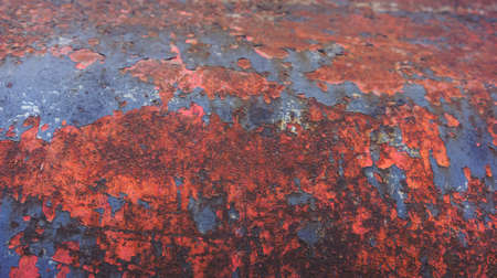 rust red: the old curved iron design covered with very strong red rust and old blue paint