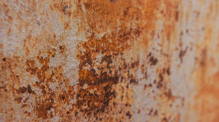 rust covered: piece of the old damaged metal gate of various shades covered with a rust